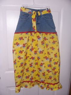 levi skirt, cut the top off of an old pair of jeans and sew on 20-22inch tube of favorite fabric, trim trim 3 inch ruffle,and match up with fabric belt.