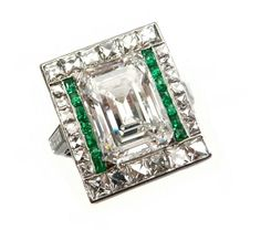 S.J. Philips deco rectangular cut diamond and gem set cluster ring, centred by a emerald-cut diamond