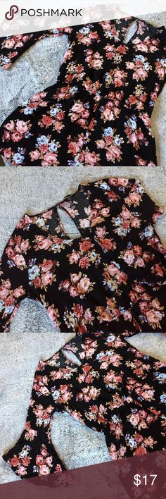 🆕 Black Floral Forever 21 Plus Romper Size 0X Black/pink floral romper from Forever 21+. Size 0X. Has bell sleeves. No zipper just a button on the top back. 100% Rayon. In great condition.  Any questions? Feel free to ask.   Pet free home.  Smoke free home. Forever 21 Pants Jumpsuits & Rompers