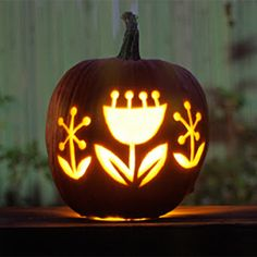 Tired of jack-o-lantern faces? Try making a pretty, flower-themed pumpkin.