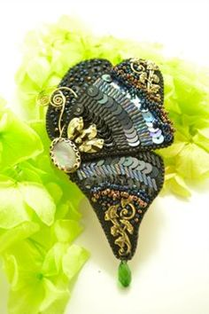 The brooch made from bead embroidery.    my work