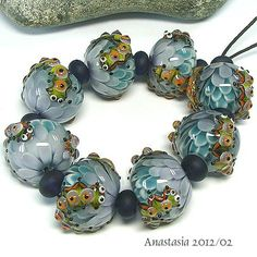 Anastasia!  One of my very favorite lampwork artists!  I have the pleasure of owning one of her beads.  I keep it in a box to view, just for me!  :D