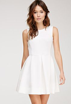 simple, white dress good for any outing; you can add a scarf or a statement necklace for a pop of color
