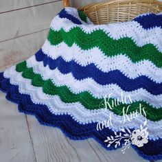 Blue, green and white crochet baby blanket. This is a very special handmade crochet baby blanket.  This baby afghan will make a wonderful baby shower gift.  This blanket would make a lovely addition to your baby nursery decor. Perfect also, for travel, strollers, prams, cribs, tummy time and photo props