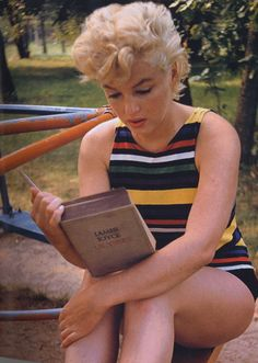 "Notice, she's almost through with the book... -- Marilyn Monroe reading James Joyce's ""Ulysses"""
