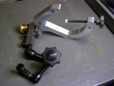 Indicol Improvements by Harvey Melvin Richards -- My Indicol has always been difficult to get tight. It's also difficult to fine adjust (even with an Adjustol). I decided to take my Noga 1018 adjustable arm and make a rigid set up for it. I think the Indicol's will go into long term...