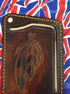 Hand carved and designed leather card and note wallet  by GCLA