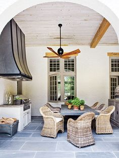 Rustic chic outdoor kitchen & dining area