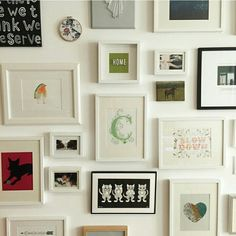 Focal wall & collection of art: love the combination of different sizes and shapes and also the mixture of photos, paintings and prints.