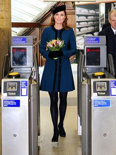 "The Duchess of Cambridge joins Queen Elizabeth II and Prince Philip at the Baker Street station Wednesday to mark the 150th anniversary of the London Underground. The duchess displayed true ""turn""-style for the occasion in a blue-and-black designer coat and black beret.  People magazine."