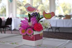 Use paper birds from the centerpieces as decoration in the room in some way.