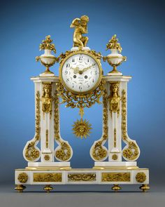 Stunning French Portico Clock crafted of luxurious Carrara marble in the Louis XVI-style, this stunning timepiece boasts cast doré bronze adornments, from the Cupid finial and flower-bearing urns to the flanking caryatids and scrolling garlands. The two-train, bell-striking movement features an enameled dial decorated with floral garlands and a sunburst pendulum, and tells time with ornate pierced gilt bronze hands, ca. 1840