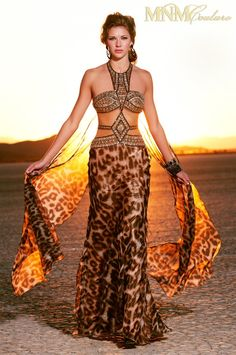 Unleash your animal magnetism in this sexy demure animal print halter gown.