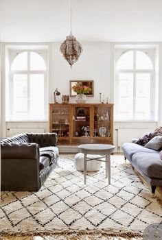 Great sofas, plush rug, and vintage curio cabinet