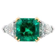 Emerald, Diamond, Platinum and Yellow Gold Ring | From a unique collection of vintage three-stone rings at https://www.1stdibs.com/jewelry/rings/three-stone-rings/