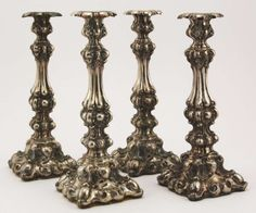 Candlestick, silver (expertized), drifted. Compilation from four einflammigen Standleuchtern with floral decoration. Blütentülle on richly f...