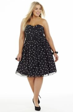 Polka Dot Party Dress Black/White Style No: D2199 Chiffon Fabric Party Dress. This strapless dress has a ruched bodice and a bow detail on the waistline. It is Fully Lined and has a Tulle underlay at the hemline. The skirt of this dress features an angled overlayer. #plussize #DreamDiva #dreamdivafiles