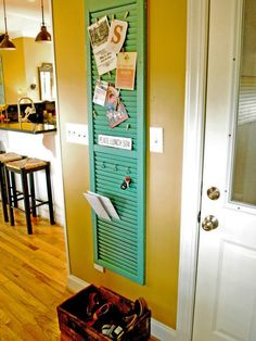 Use a vintage shutter in the entryway as an organizational system. Hang keys (by adding S hooks), store outgoing mail, etc. YES!!!! LOVE!