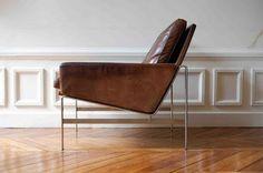 Greek key molding on wall trim, brown leather modern chair