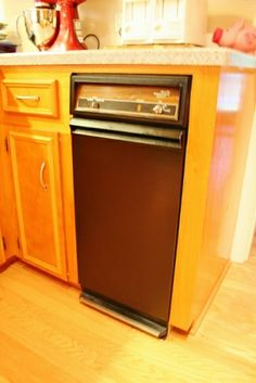 Have an outdated appliance? Just buy an appliance spray paint can for a couple of bucks and you get a whole new look! Check out how I took a pea green trash compactor to a nice black. | www.rappsodyinrooms.com #spraypaint #diy