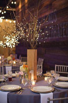 Wedding reception at Monday Night Brewing Company Orange, pink and ivory spray roses, ranunculus and hydrangeas See more beautiful designs at www.stemsatlanta.com