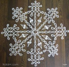 Rangoli Kolam Designs on Happy Shappy in Here you can find the most beautiful & Simple design, photos, images, free hand and more in Small & Large design Ideas Rangoli Side Designs, Rangoli Borders, Small Rangoli Design, Rangoli Patterns, Rangoli Designs Images, Rangoli Ideas, Rangoli Designs With Dots, Kolam Rangoli, Rangoli With Dots