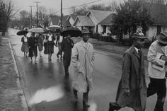The Day of Pilgrimage protest, part of the Montgomery Bus Boycott, begins with black Montgomery citizens walking to work in 1956, in the wake of the Rosa Parks incident.