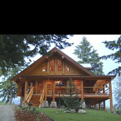 Log home with wrap around porch. Like the offset steps and door.