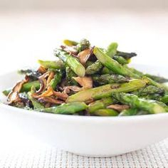 Stir fried asparagus with shitake mushrooms - America's Test Kitchen. Need to register to access recipes.