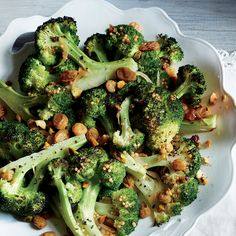 Roasted Broccoli with Pistachios and Pickled Golden Raisins | MyRecipes