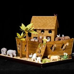 This boat was made from gingerbread covered with a layer of fondant. The animals are molded from fondant and marzipan, and hand painted. Created by Barbara E. of Edelstein, IL and Mary Jo D. of Westford, MA. See more details of this gingerbread ark.