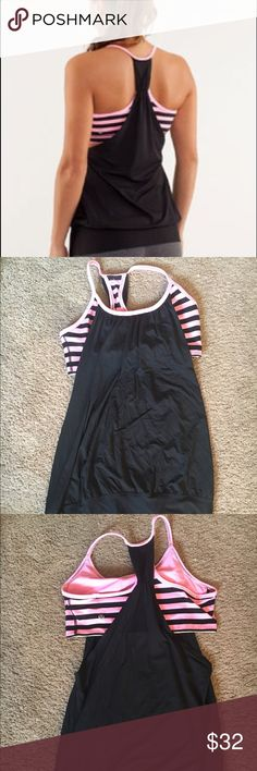 Lululemon No limits striped tank This pink and black striped tank comes with bra attached. Only worn a handful of times and in very good condition. lululemon athletica Tops Tank Tops