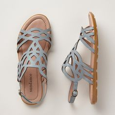 INFINITE PATH SANDALS--Supple, cutout leather evokes intricate Celtic knots in a fanciful take on the classic T-strap. Padded insoles for all day adventuring. Imported. Exclusive. Euro whole sizes 36 to 41. 36 (US 5.5), 37 (US 6.5), 38 (US 7.5), 39 (US 8.5), 40 (US 9.5), 41 (US 10.5).