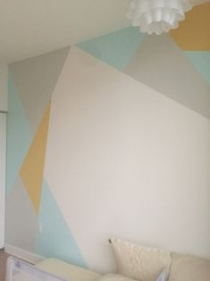 I finally painted the wall in the boys bedroom! Painted the wall white then taped off and painted the blue triangles, let them dry, taped off and painted yellow triangles, let them dry, taped off and painted the gray triangles and let them dry. It took 6 hours, but with good quality paint and patience it's worth it and will last a long time!