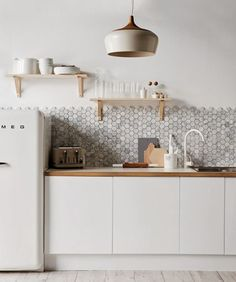 Stylish Kitchen | tile wall, wood countertop, retro white fridge, lamp shade