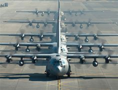 Six C-130 Hercules cargo aircraft line up before flying during a readiness week at Yokota Air Base, Japan. The 374th Airlift Wing uses C-130s to support combatant commanders in the Pacific region.... Image: Top Gun: Best pics from the US Air Force (© REX FEATURES/USAF)