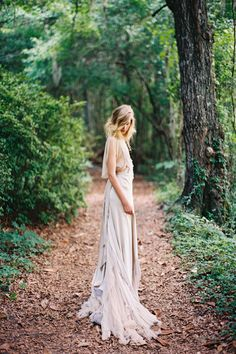 Outdoor wedding editorial in unusual pale gown.