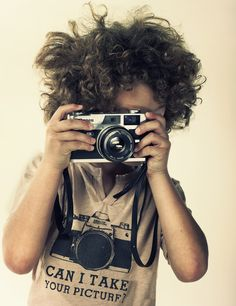 I'm obsessed with this kid's hair, shirt, and camera!