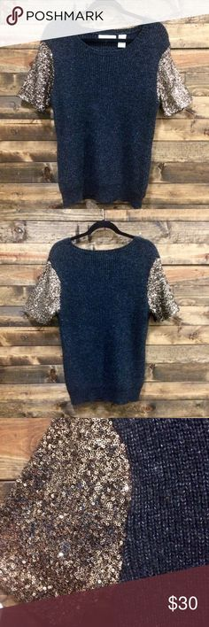 Kersh Sweater in Navy w/Bronze Sequin Sleeves-SZ L Super cute Kersh sweater in Navy(woven into color are white/grey specks) with bronze sequin sleeves. Sequins may look lighter or gold in some light. Size Large.  Excellent condition-gently worn and only a couple of times.  Perfect for fall and winter.  Versatile to wear with skinny jeans and boots or out for the night in a leather skirt with heels.  Add a belt for a more fitted style.  Sweater: 68% acrylic, 17% polyester, 9% wool, 6% Nylon…