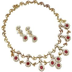 18 karat gold, ruby and diamond necklace and earrings | Lot | Sotheby's