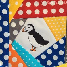 Scrappy, spotty, patchwork quilt block with one of my puffin designs in the centre. The puffin fabric is available from the Sea Parrot Folksy online shop.