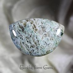 This rare Wiggins Fork Moss Agate has billowy moss inclusions in a dreamy sage green with a blue tint, for which this material is best known. Wiggins Fork Moss Agate has always been one of my favorite of the moss agates, and this large well-domed cabochon is a prime example and will be a Agates, Moss Agate, Gems And Minerals, Opals, Fork, Natural Stones, Sage, Crystals, Salvia