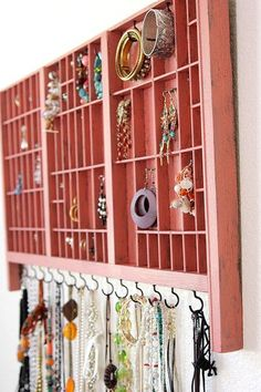 """Homemade jewelry Organizer."" Also: could use wooden or bamboo cutlery trays & drawer organizers, turned on their sides against a wall like this, as display shelves for miniature little items."