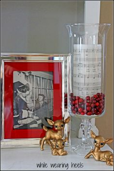 Print sheet music onto tissue paper and heat onto a candle with blow dryer. Add cranberries into a candle holder and done!