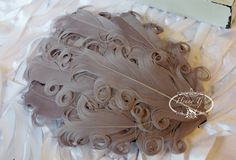 TAUPE Nagorie Feather Pad - Feather Pad - Curly Feathers - Goose Feather Pad. $3.20, via Etsy.