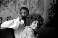 Miles Davis and his wife, funk singer, Betty Davis in front of one of his paintings at their home in New York City, October 1969. Photos by Baron Wolman