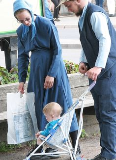 Amish family in unusual blue dress