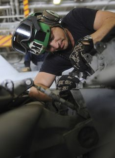 """GULF OF OMAN (June 17, 2013) Aviation Structural Mechanic 2nd Class Camilo Moreno, a native of Brooklyn, N.Y., performs an 84-day maintenance inspection of an F/A-18E Super Hornet from the """"Argonauts"""" of Strike Fighter Squadron (VFA) 147 in the hangar bay of aircraft carrier USS Nimitz (CVN 68). Nimitz Strike Group is deployed to the U.S. 5th Fleet area of responsibility conducting maritime security operations. (U.S. Navy photo by Derek W. Volland/Released)"""