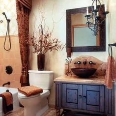 hacienda style bath. Web site not right but like the blue with earth tones hint of gold in fabric.