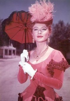 Amanda Blake as Kitty Russell
